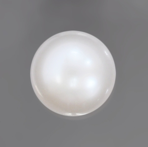 A stunning 7 carat Natural Pearl. White and round top luster is seldom seen in nature.
