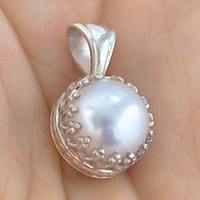 Chinese Tissue Pearl Pendant in a silver, gallery-style setting